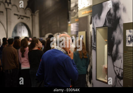 New York, USA. 28th Apr, 2014. A visitor watches exhibits about hisitory of Holocaust in the Museum of Jewish Heritage - Stock Photo