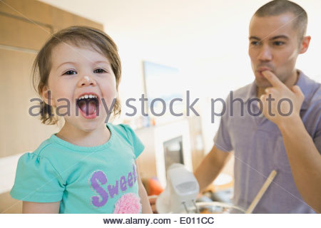 Father and daughter baking in kitchen - Stock Photo