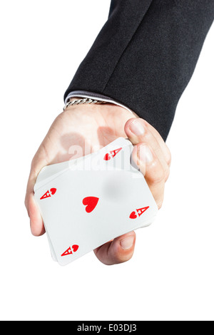an elegant young businessman showing an ace of hearts in his hand - Stock Photo