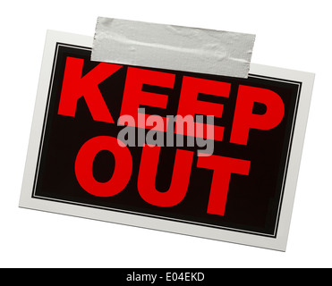 Red and black keep out sign with tape holding it up isolated on a white background. - Stock Photo