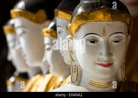 series Buddhas shwedagon pagoda Yangon Myanmar Burma - Stock Photo