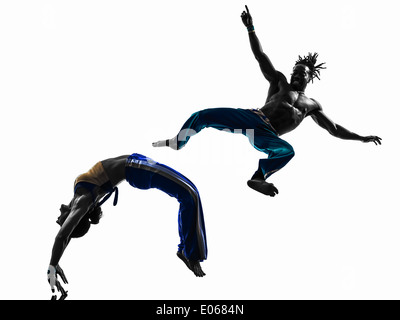 two people couple capoeira dancers dancing in silhouette studio isolated on white background - Stock Photo