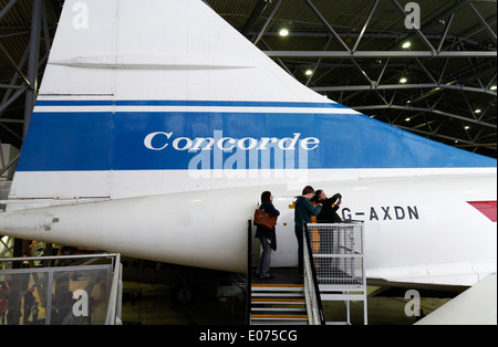 Visitors on Concorde at Duxford Air Museum - Stock Photo