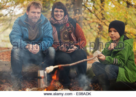 Family camping in forest - Stock Photo