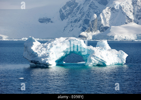 arched iceberg in wilhelmina bay Antarctica - Stock Photo