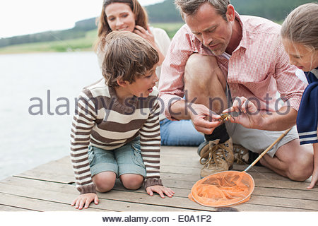 Father showing family small crab - Stock Photo