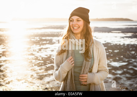 Happy young woman on the beach - Stock Photo