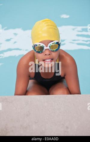 Portrait of schoolgirl swimmer poolside - Stock Photo