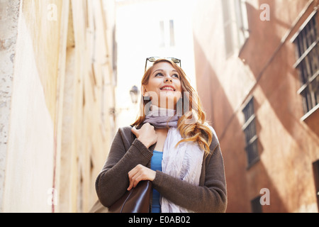 Young woman exploring streets, Rome, Italy - Stock Photo