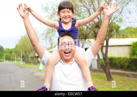 happy Father and little girl with sunset background - Stock Photo