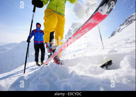 Two cross-country skiers ascending to mount Sulzspitze, Tannheim Mountains, Allgaeu Alps, Tyrol, Austria - Stock Photo