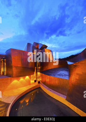 Night view of The Guggenheim Museum in Bilbao, Biscay, Basque Country, Spain - Stock Photo