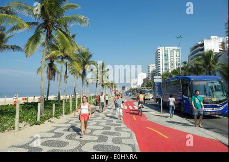 RIO DE JANEIRO, BRAZIL - APRIL 1, 2014: Bus stops along boardwalk bike path on Avenida Vieira Souto in Ipanema. - Stock Photo
