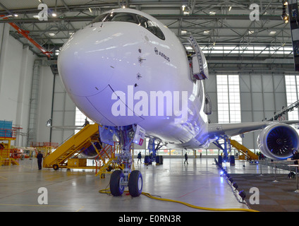 An Airbus A350XWB at the Airbus headquarters in Finkenwerder, Hamburg, Germany - Stock Photo