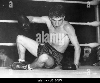 Boxer Dai Dower on the ground during a match - Stock Photo