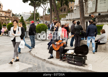 Street entertainer playing the guitar, Rome city center, Rome, Italy Europe - Stock Photo