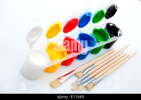 Paints and brushes, on White Background - Stock Photo