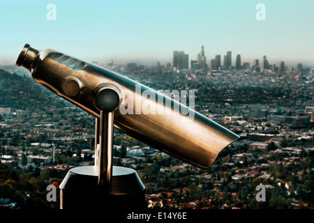 Chrome telescope with Downtown Los Angeles in background - Stock Photo