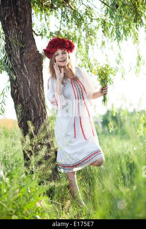 emotional girl in traditional ukrainian costume - Stock Photo
