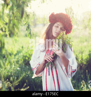 Emotional portrait of ukranian woman with bouquet of flowers - Stock Photo