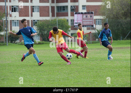 Junior football players fighting for the ball, Cape Town, South Africa - Stock Photo