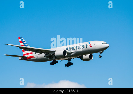 American Airlines Boeing 777 on approach to land at London Heathrow airport - Stock Photo