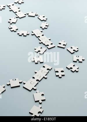 Connecting jigsaw pieces - Stock Photo