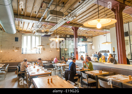 Caravan restaurant in Granary Square, King's Cross, London, England, UK - Stock Photo
