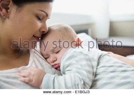 Serene mother and baby sleeping - Stock Photo