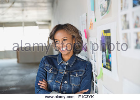 Portrait of confident businesswoman in new office - Stock Photo