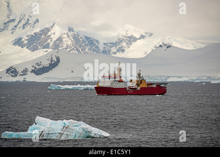 A scientific survey research ship on the water offshore in Antarctica. - Stock Photo