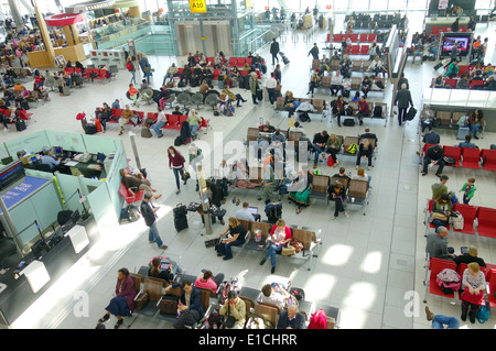 London Heathrow Airport waiting area at a terminal in London, UK - Stock Photo