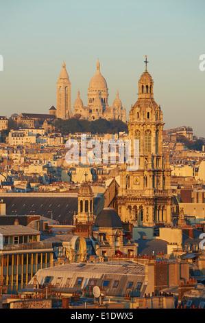 France, Paris, Sacre Coeur Basilique and Trinite church - Stock Photo