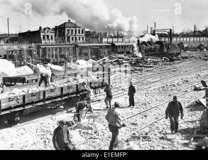 Propaganda text! from Nazi news reporting on the back of the picture: 'Kharkov train station cleared of debris of - Stock Photo