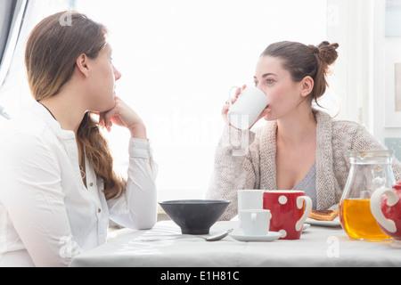 Young women having breakfast - Stock Photo