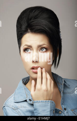 Neatness. Adorable Teen Girl with Black Hairs and Guiff  Daydreaming - Stock Photo