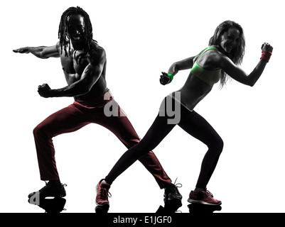 couple man and woman exercising fitness zumba dancing in silhouette on white background - Stock Photo