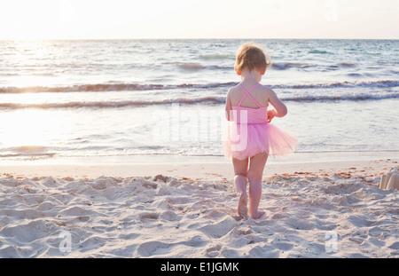 Girl wearing tutu on beach in Tulum, Mexico - Stock Photo