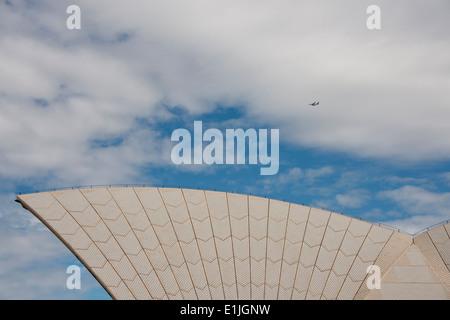 Australia, NSW, Sydney. Sydney Opera House, roof detail with airplane. - Stock Photo
