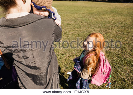 Mid adult mother, baby son and daughter strolling in park - Stock Photo