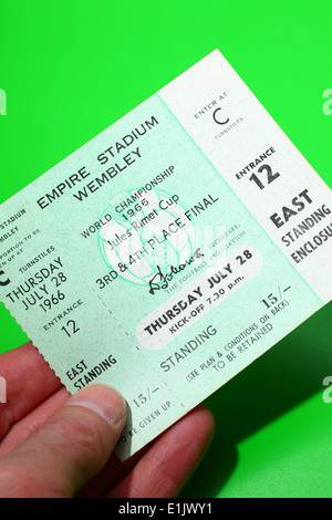 Person holding original 1966 World Cup tickets for the 3rd & 4th Place Final match - Portugal V Soviet Union on - Stock Photo