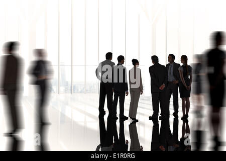Composite image of business colleagues standing - Stock Photo