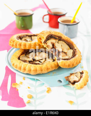 Pear and chocolate spread puff pastry tartlets - Stock Photo