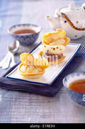 Apple-pear and chocolate-pear tartlets - Stock Photo