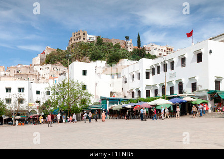 View of the local cafes and restaurants in the main square at the hilltop town of Moulay Idriss near  Meknes in - Stock Photo