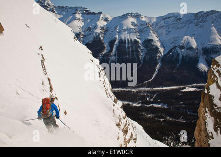 A male backcountry tele skier descends a coulior on Mt. Patterson, Icefields Parkway, Banff, AB - Stock Photo
