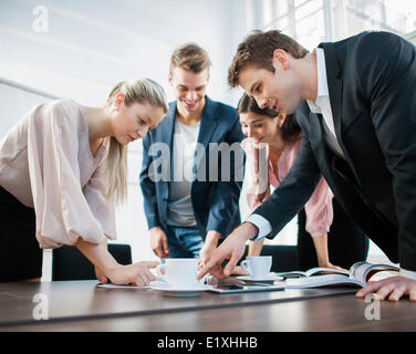 Young business people brainstorming at conference table - Stock Photo
