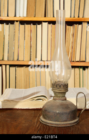 Vintage still-life with books and parafin lamp - Stockfoto