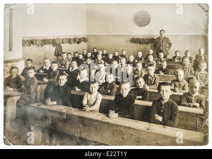 BERLIN, GERMANY - CIRCA 1900: antique portrait of classmates. group of children in the classroom - Stock Photo