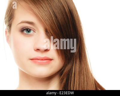 Female hairstyle. Portrait of girl with makeup and long bang covering her eye isolated on white. - Stock Photo